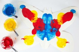 Butterfly-symmetry-painting-with-red-yellow-and-blue-paints